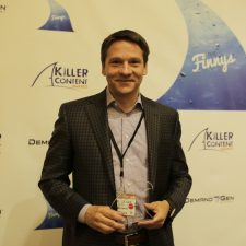Chris Golec, CEO, Demandbase shows off his Account-Based Marketing KCA Award.