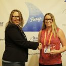 Natalee Thomas, Associate Market Development Manager, Thermo Fisher Scientific wins a Finny in the Sales Enablement category (pictured here with Carol Krol, EIC, Demand Gen Report, left).