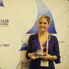 Lauren Harper, Sr. Manager Global Social Marketing, Oracle Marketing Cloud strikes a pose with her Killer Content Award for Design Concept & Theme.