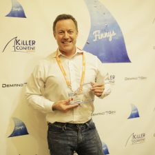 Jim D'Arcangelo, SVP of Marketing, Booker, poses with their award for innovative video content.