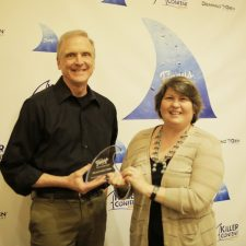 KC Chartrand, Director, Content Marketing, IHS & Barbara Thomas, President, Creative Tactics with their Killer Content Award for Customer Lifecycle Marketing.