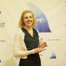 Sarah Dietze, Account Director, Walker Sands Communications proudly strikes a pose with her Finny award for her Agency/Publisher Partnership entry.