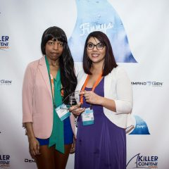 Lucie Calloway Natasha Ness of LeadMD accepting their Finny for Design Concept & Theme.