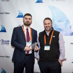 Ireneusz Klimczak and Zakary Barron of GetResponse accepting their Influencer Content Finny.