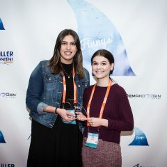Michaela Scampoli and Mia Patton of Datto accepting their Finny for Research-Based Content.