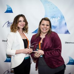 Clare Kirlin and Anati Zubia of Infusionsoft accepting the Finny for Nurture Programs.