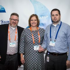 Mark Evertz of Televerde, Elizabeth Graham and Ryan Jensen of Republic Services accepting the Finny for Sales Enablement.